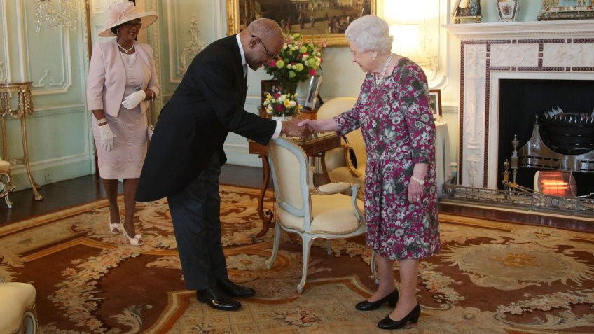 His Excellency Seth George Ramocan, the High Commissioner for Jamaica, presents his Letters of Commissioner, accompanied by his wife Dr Lola Ramocan, during a private audience with Queen Elizabeth II at Buckingham Palace, London.