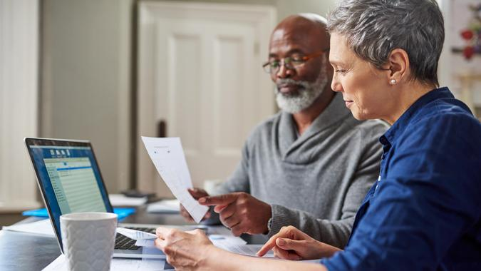 Cropped shot of a senior couple working on their finances at home.