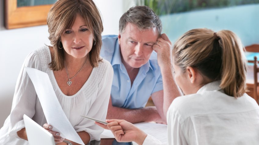 Worried mature Couple in Meeting With Advisor at home.