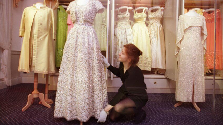 Curator Jenny Lister Arranges One Of Many Of The Queen Elizabeth II's Dresses On Display At A New Exhibition At Kensington Palace.