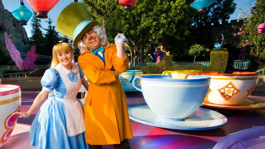 """A VERY MERRY UN-BIRTHDAY -- Alice and the Mad Hatter from the classic Walt Disney animated feature """"Alice in Wonderland"""", pose at the Mad Tea Party at Disneyland in Anaheim, Calif."""