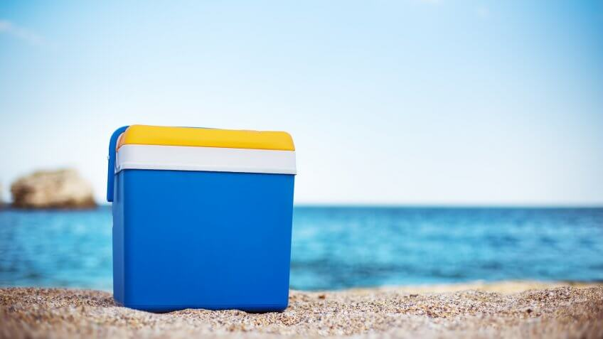 Blue cooler box on the beach.