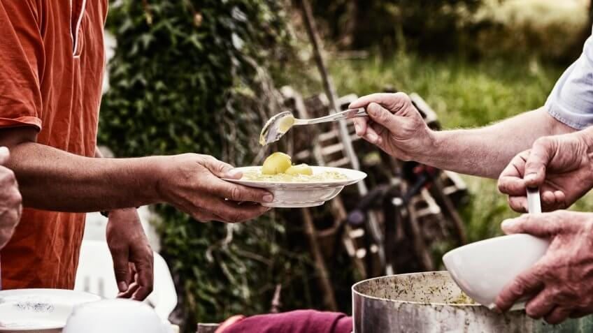 soup kitchen serving food for poor people