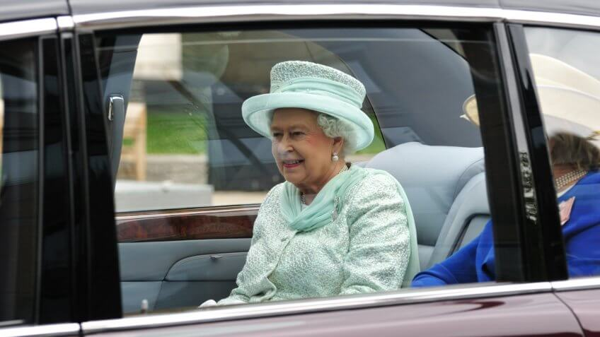 Queen Elizabeth II drives in motorcade with The Lady Farnham