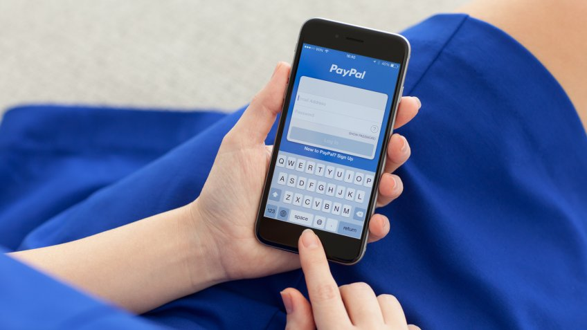 Alushta, Russia - December 3, 2014: Woman holding a iPhone 6 Space Gray with service PayPal on the screen.