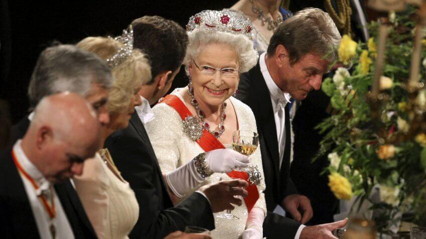Queen Elizabeth II toasts with France's President Nicolas Sarkozy and wife Carla Bruni Sarkozy