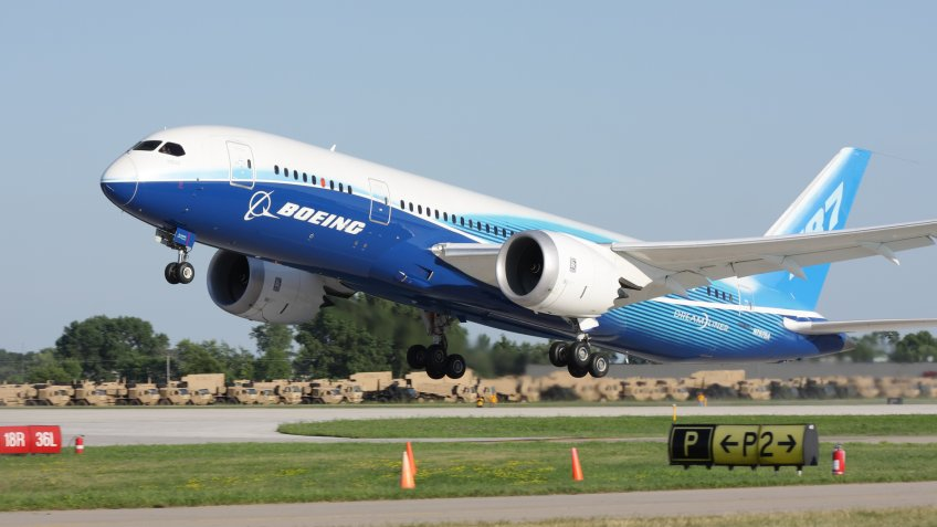 """""""Oshkosh, WI, USA - July 29, 2011:  Brand new Boeing 787 Dreamliner in factory paint scheme taking off during EAA Airventure 2011."""