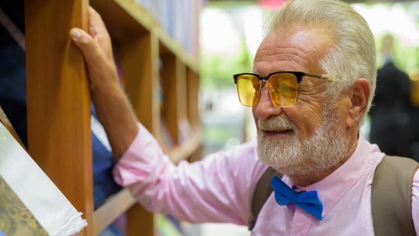 Portrait of senior handsome man wearing stylish clothes while shopping in Bangkok Thailand horizontal shot.