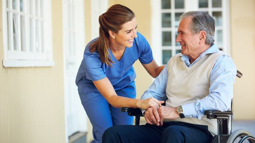 Shot of a doctor caring for her senior patient at a nursing homehttp://195.