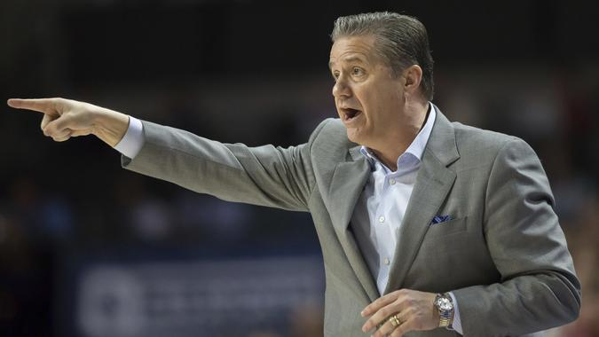 Mandatory Credit: Photo by Ron Irby/AP/REX/Shutterstock (9447984d)Kentucky head coach John Calipari directs traffic during the first half of an NCAA college basketball game against Florida in Gainesville, Fla.