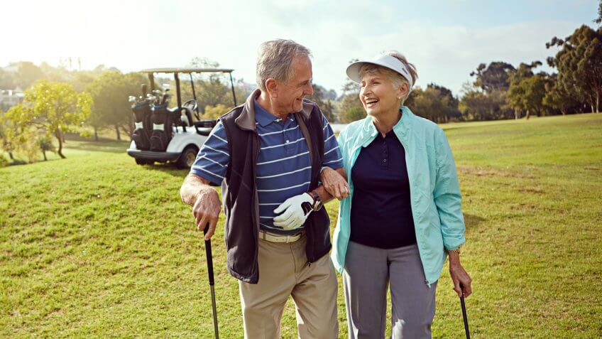 Shot of a smiling senior couple enjoying a day on the golf course.