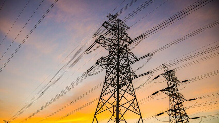 Electric power lines at sunset.