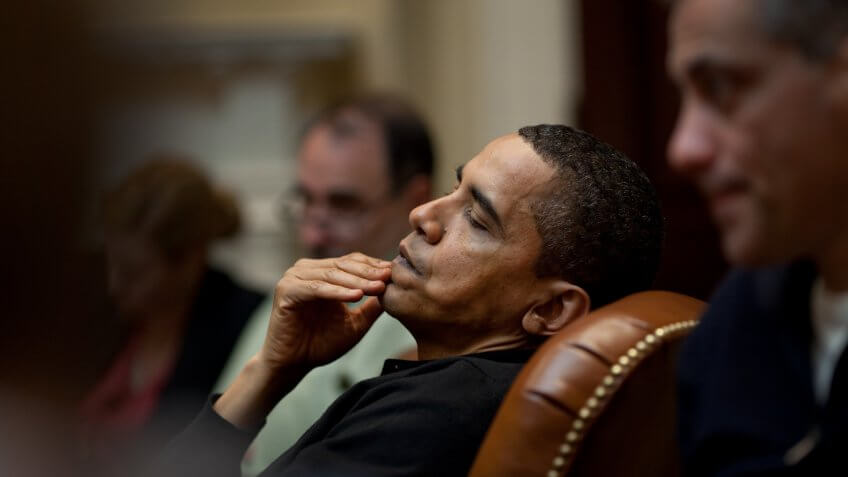 President Obama reflects during an economic meeting with advisors in the Roosevelt Room.