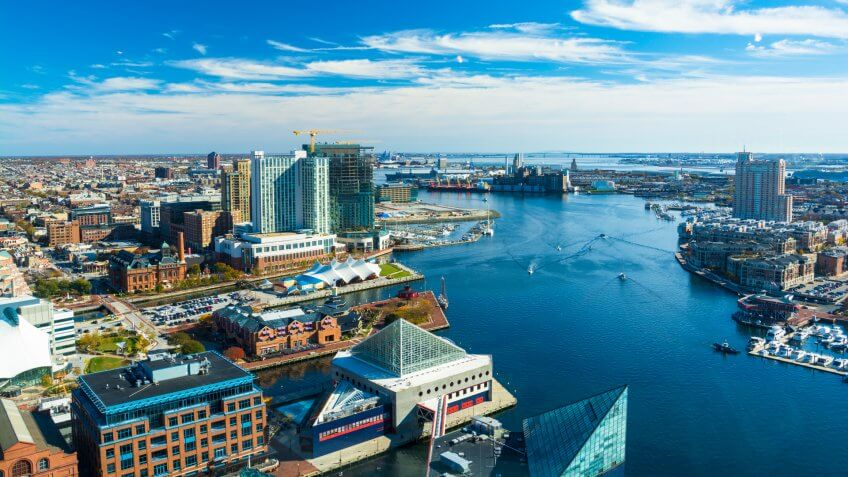 Aerial of Baltimore City with the Patapsco River and waterfront buildings.