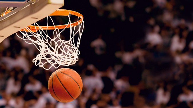 Scoring the winning points at a basketball game.