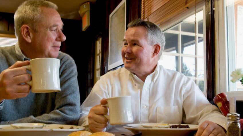 Two senior men in a restaurant.