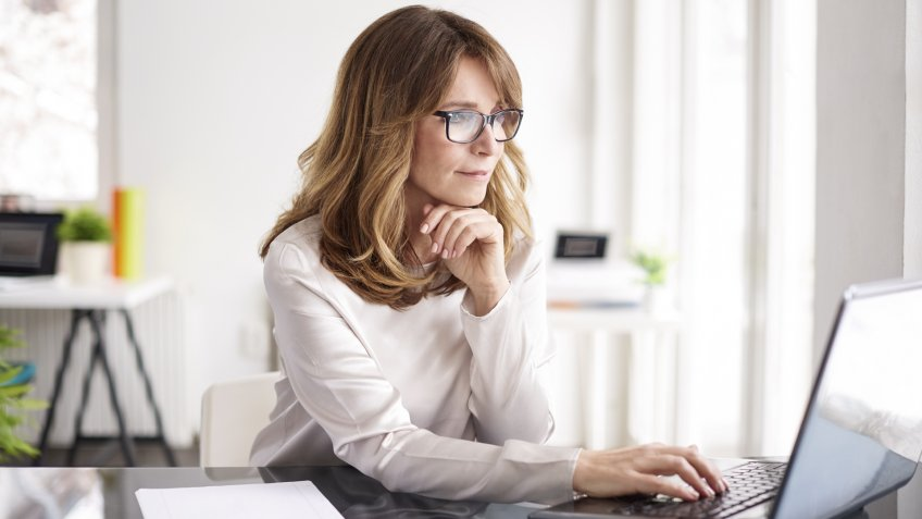 Shot of an attractive mature businesswoman working on laptop in her workstation.
