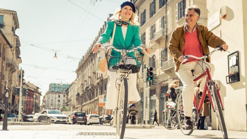 Senior couple riding bicycle.