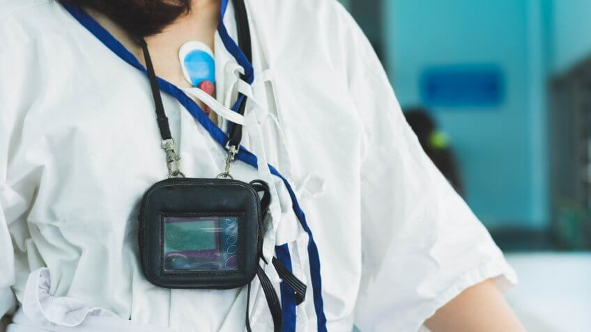 patient wearing holter monitor device for monitoring of an electrocardiogram 24 hour Heart investigation activity.