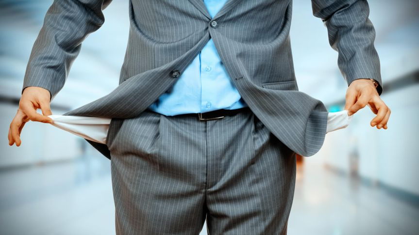Man Pulling out Empty Pocket on office background.