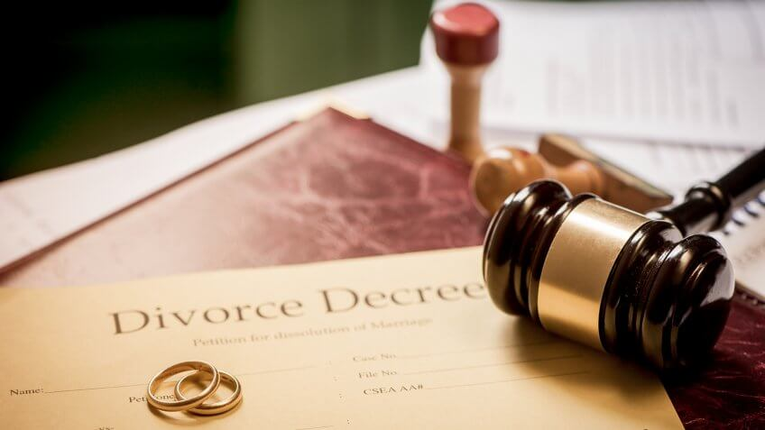 Divorce decree and wooden gavel.