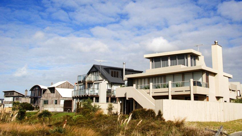 modern beach homes on a sunny day.