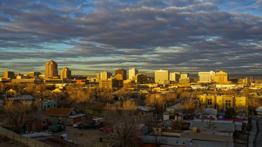 Albuquerque, New Mexico, USA - January 26, 2017:  The downtown city skyline of Albuquerque, New Mexico early in the morning as the sun illuminates the buildings with a golden glow.
