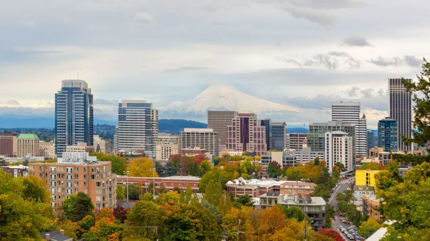 Portland Oregon downtown city skyline and snow covered Mount Hood view in Fall Season America.