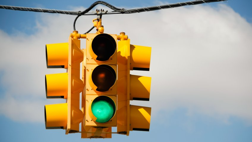 Green light on a traffic signal at an intersection.