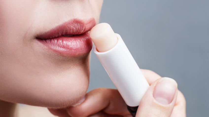 applying lip balm