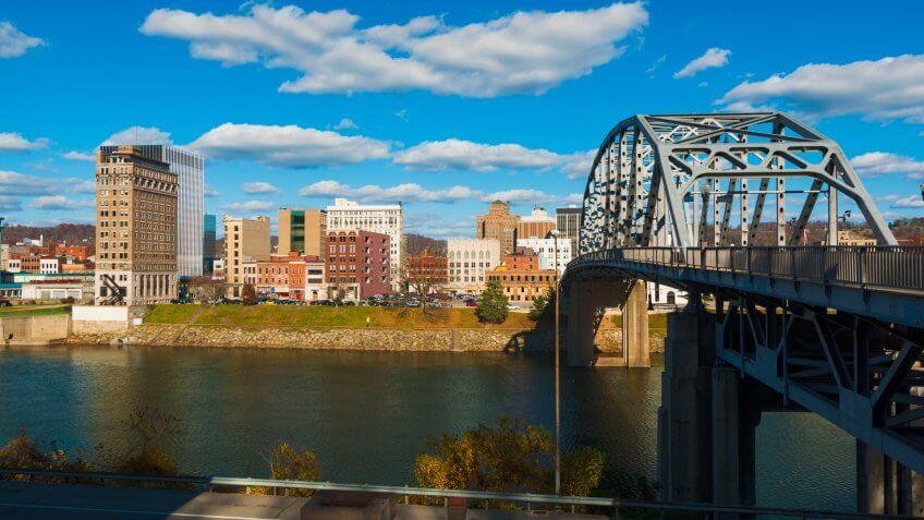 Charleston, West Virginia skyline, South Side Bridge, and the Kanawha River.
