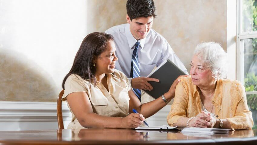 Senior Hispanic woman (70s) getting professional advice.