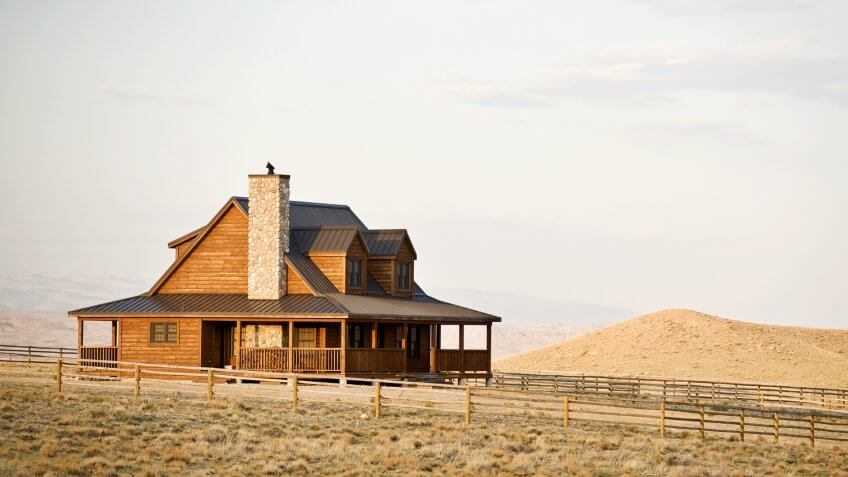 Ranch house newly constructed in late sun, rural midwest United States.