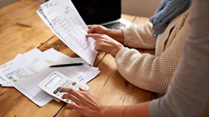 Cropped view of a senior woman receiving help with her finances from her granddaughterhttp://195.