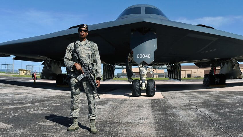 An Airman assigned to the 28th Security Forces Squadron guards of a B-2 Spirit during the 2011 Dakota Thunder airshow at Ellsworth Air Force Base, S.