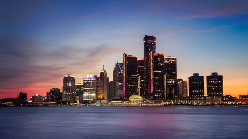 A cityscape of Detroit, Michigan at dusk.