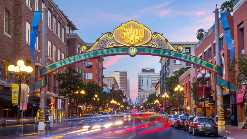 Downtown San Diego Gaslamp sign over moving traffic.