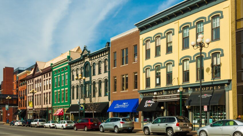 Lexington, United States - November 11, 2012: Victorian Square shoppes on the right and other classic victorian styled buildings on the left.