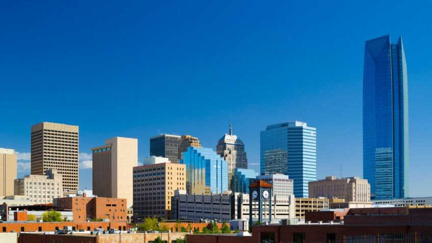 Oklahoma downtown skyline with a deep blue sky, featuring the new Devon Energy Center building.