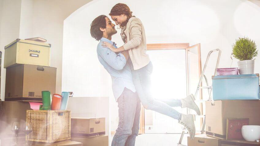 Young couple moving in into new apartment.