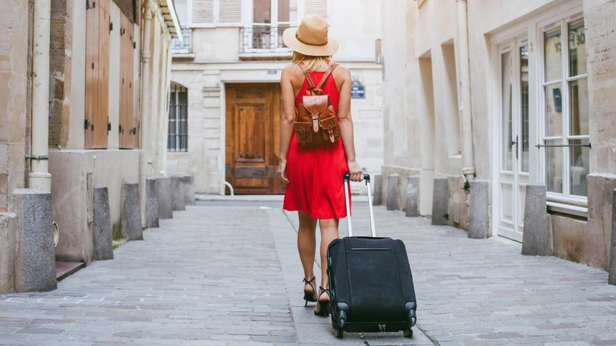 tourist walking with suitcase