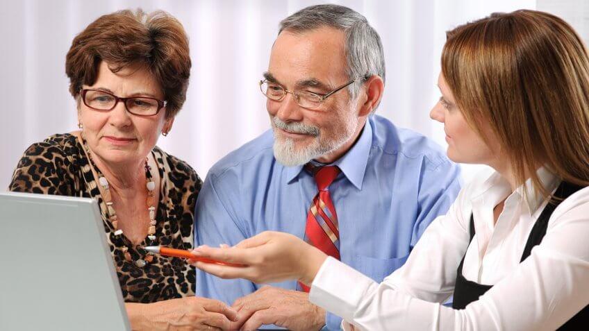Senior couple meeting with adviser.
