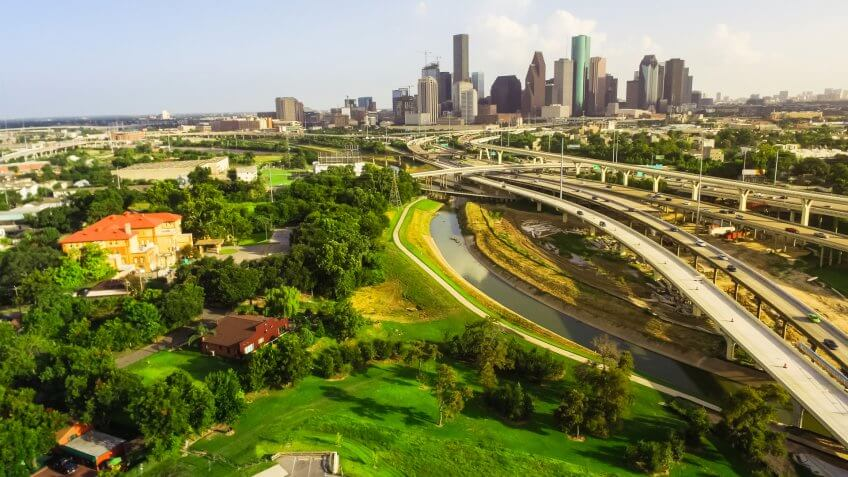 Aerial view downtown and interstate I45 highway with massive int, Texas, USA, road junction overpass and elevated road construction at sunset , stack interchange