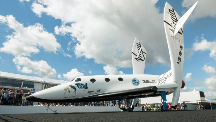 FARNBOROUGH, UK - JULY 15: The futuristic Virgin Galactic reuseable, sub-orbital spacecraft on static display at the Farnborough International Airshow, UK on July 15, 2012.