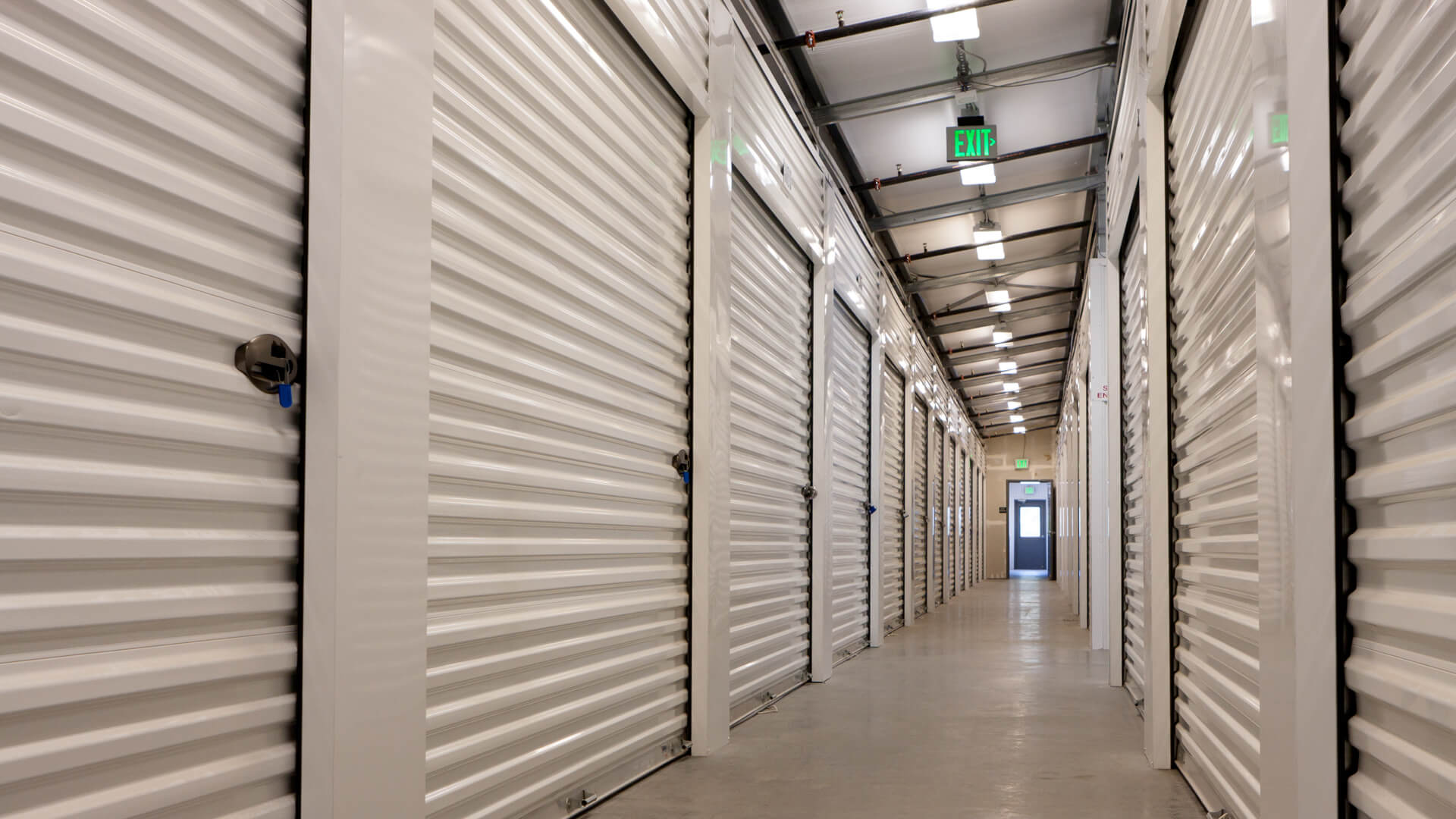 Looking down an empty hallway of a storage facility