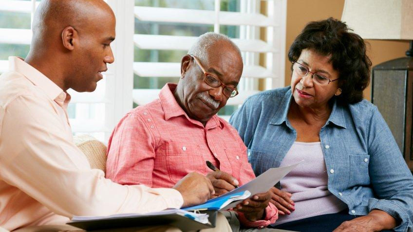 Financial Advisor Talking To Senior Couple.