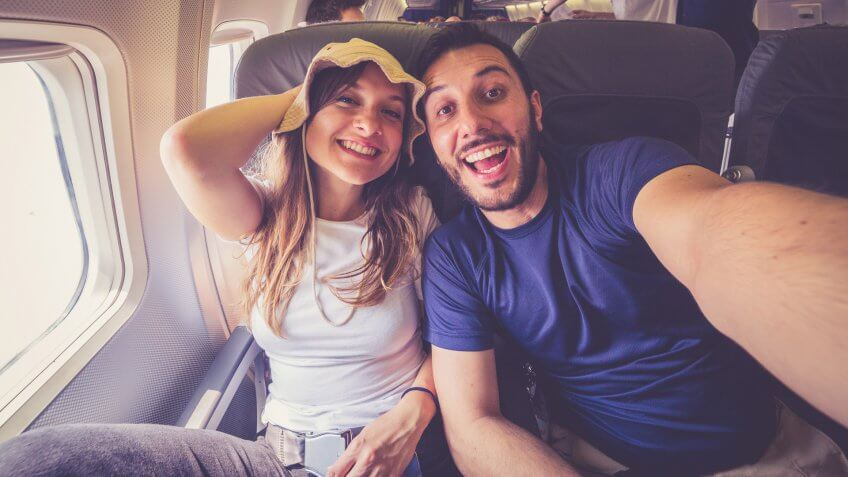 couple taking a selfie on the airplane