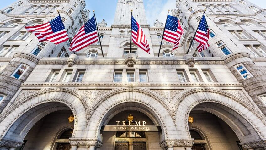 Washington DC, USA - January 28, 2017: Trump International Hotel and the Old Post Office Tower entrance with american flags.