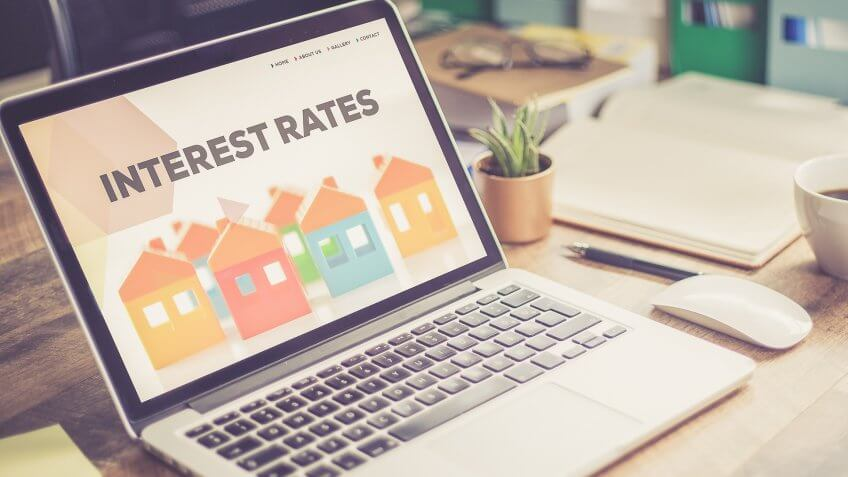 Reviewing interest rates on a laptop