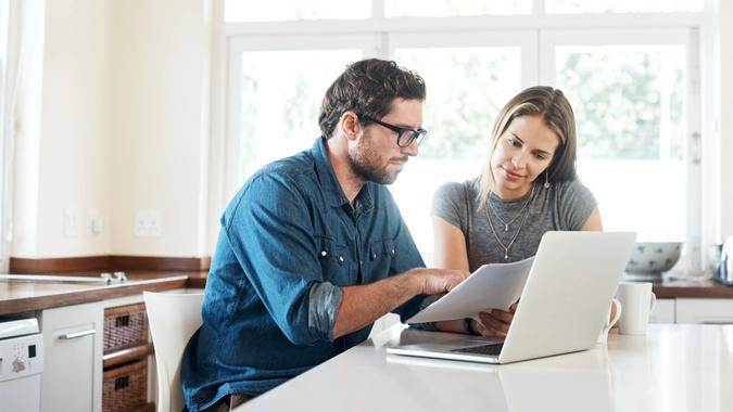 Shot of a young couple working on their finances together at home.